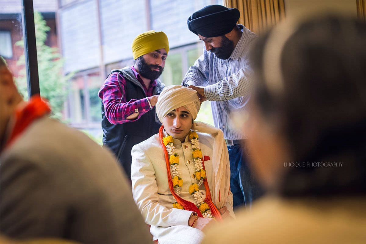 Groom having his pagg (Turban) tied | Indian Wedding Photographer Cheshire | 06