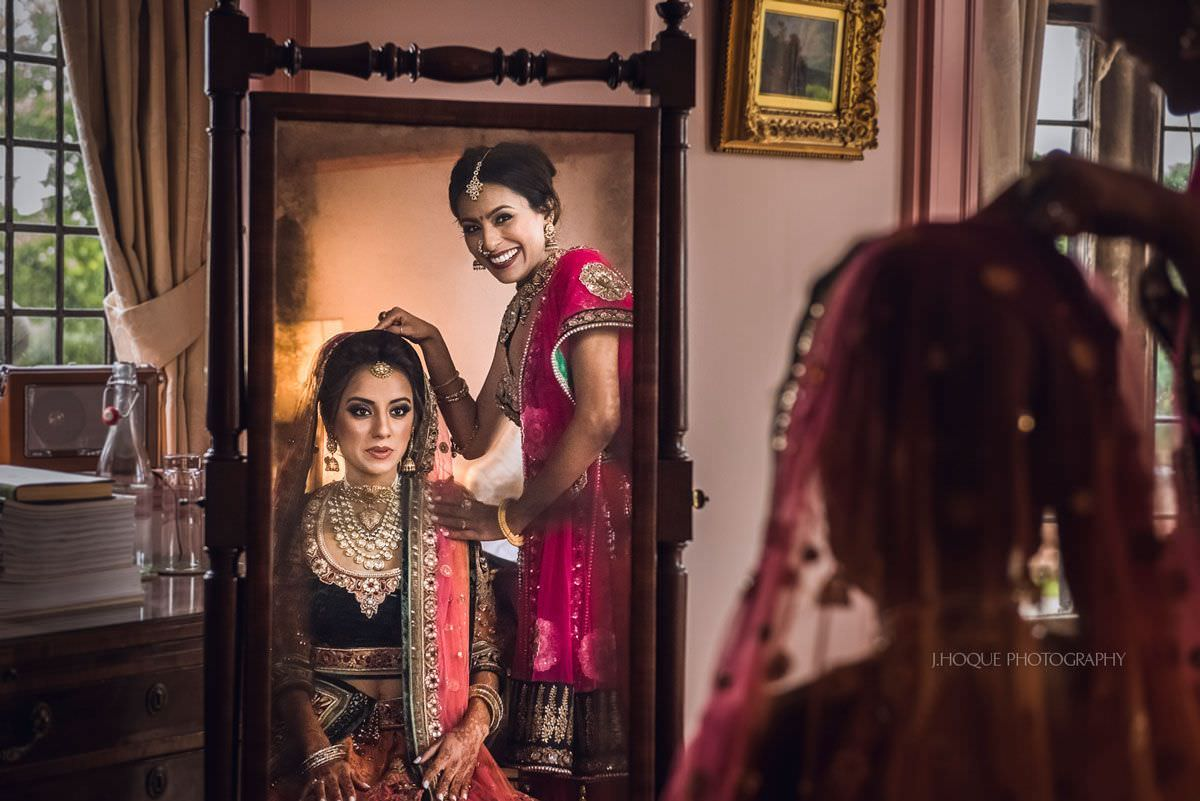 Reflection of bride and sister | Luxury Indian Wedding Photography at Thornton Manor | 25