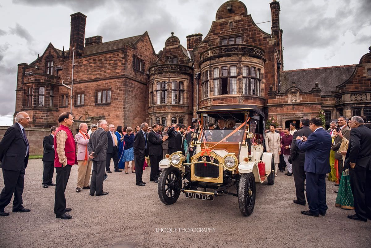 Bride and groom leave in classic car | Luxury Hindu Wedding Photographer Thornton Manor | 46