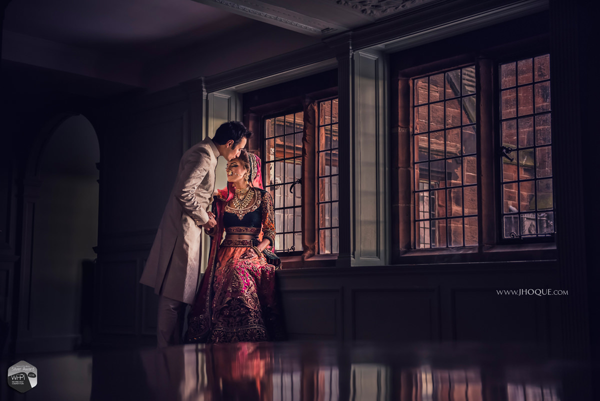Bride and groom portrait by window | WPPI Silver Award Winning Image | Luxury Asian Wedding at Thornton Manor Cheshire