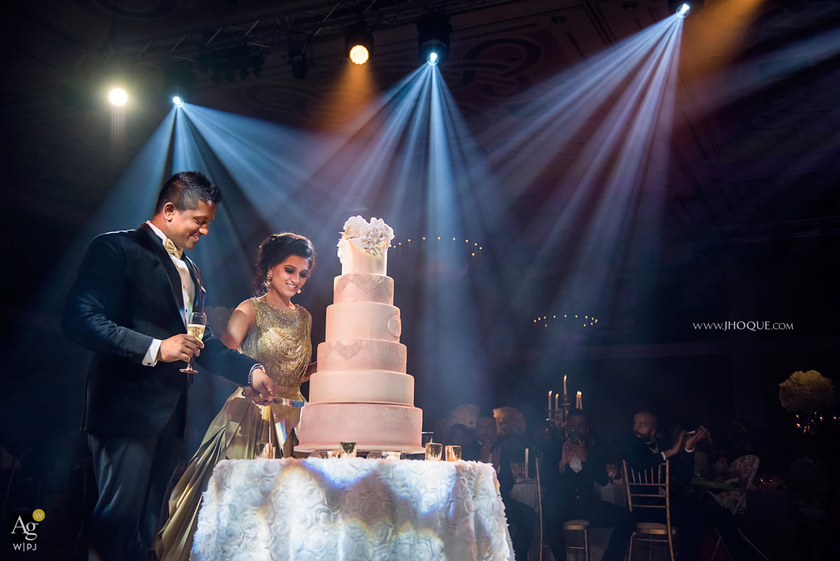 Bride and groom cutting cake | AG|WPJA Award - Q3 2016 | Luxury Asian Wedding at Celtic Manor Resort Wales | Maya Dahlia Cakes | Pro System Services
