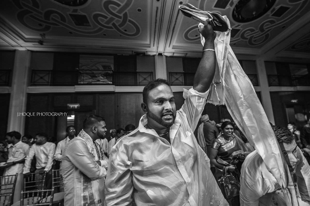 Guest steals grooms shoes   Luxury Documentary Asian Wedding Photography at Celtic Manor Resort