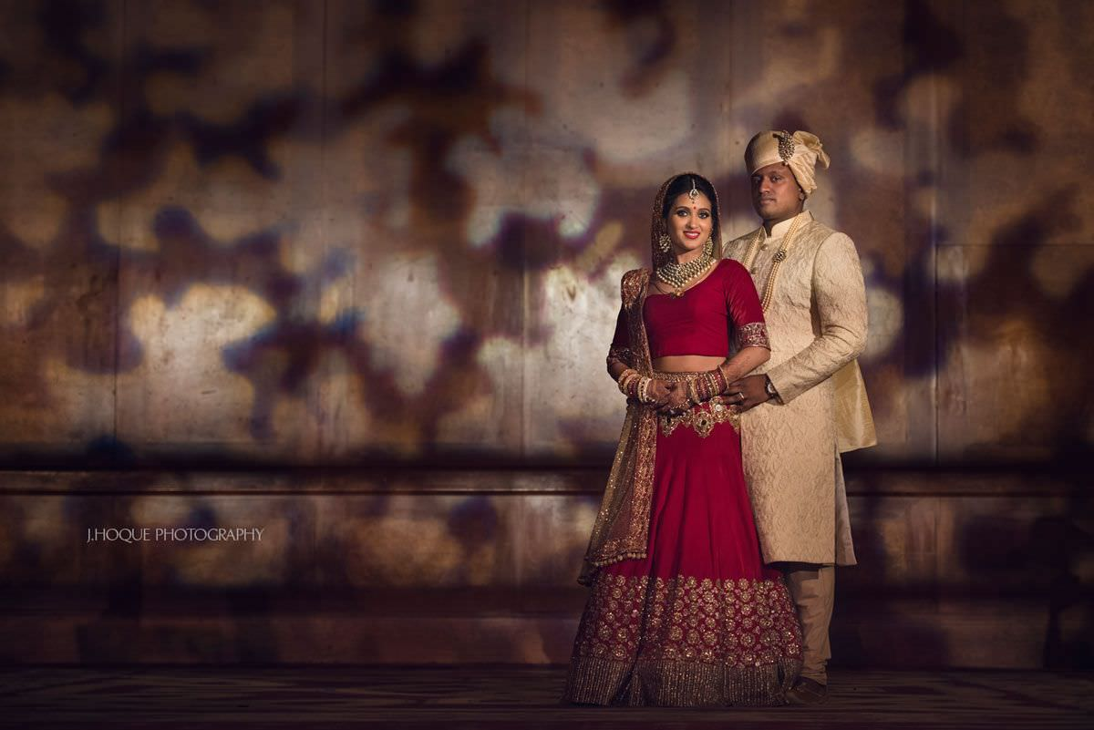 Bride and groom portrait with unique lighting in background | Luxury Hindu Fusion Wedding at Celtic Manor Resort Wales