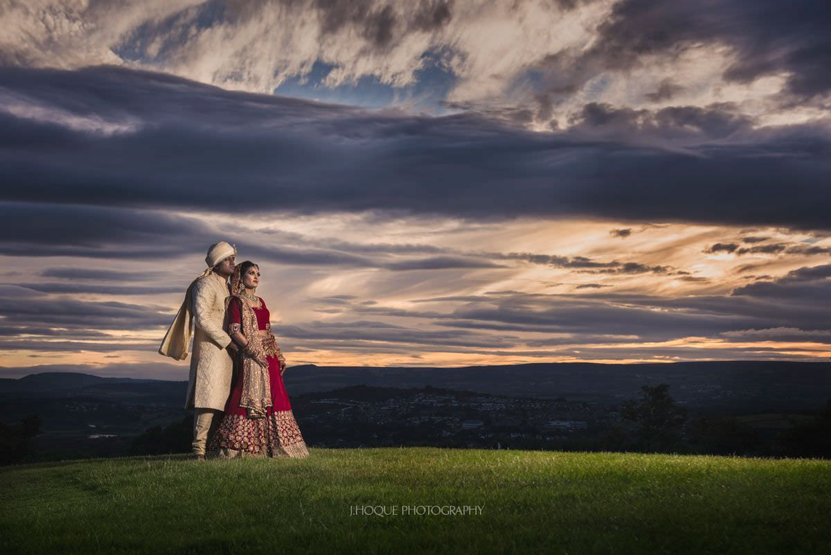 Wedding portrait with dramatic clouds at sunset   Luxury Asian Fusion Wedding Wales