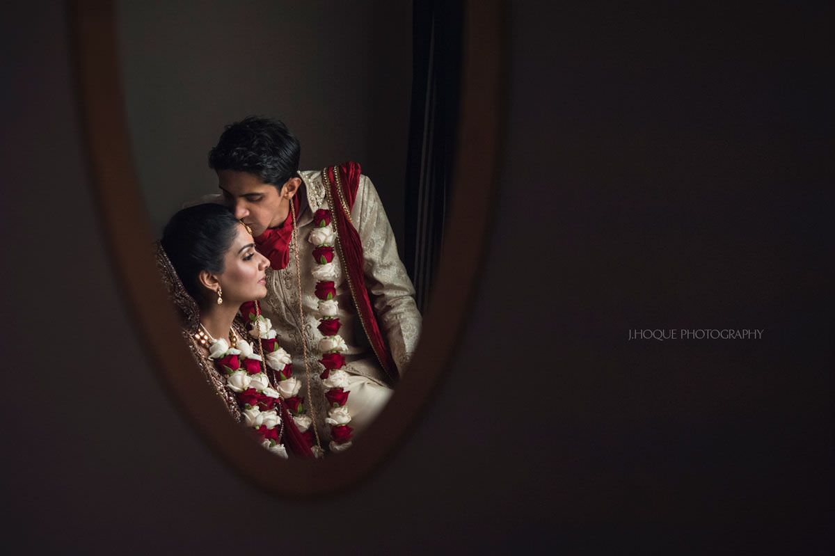 Reflection in mirror of Indian Bride and groom   Luxury Asian Photography London   Intercontinental Park Lane