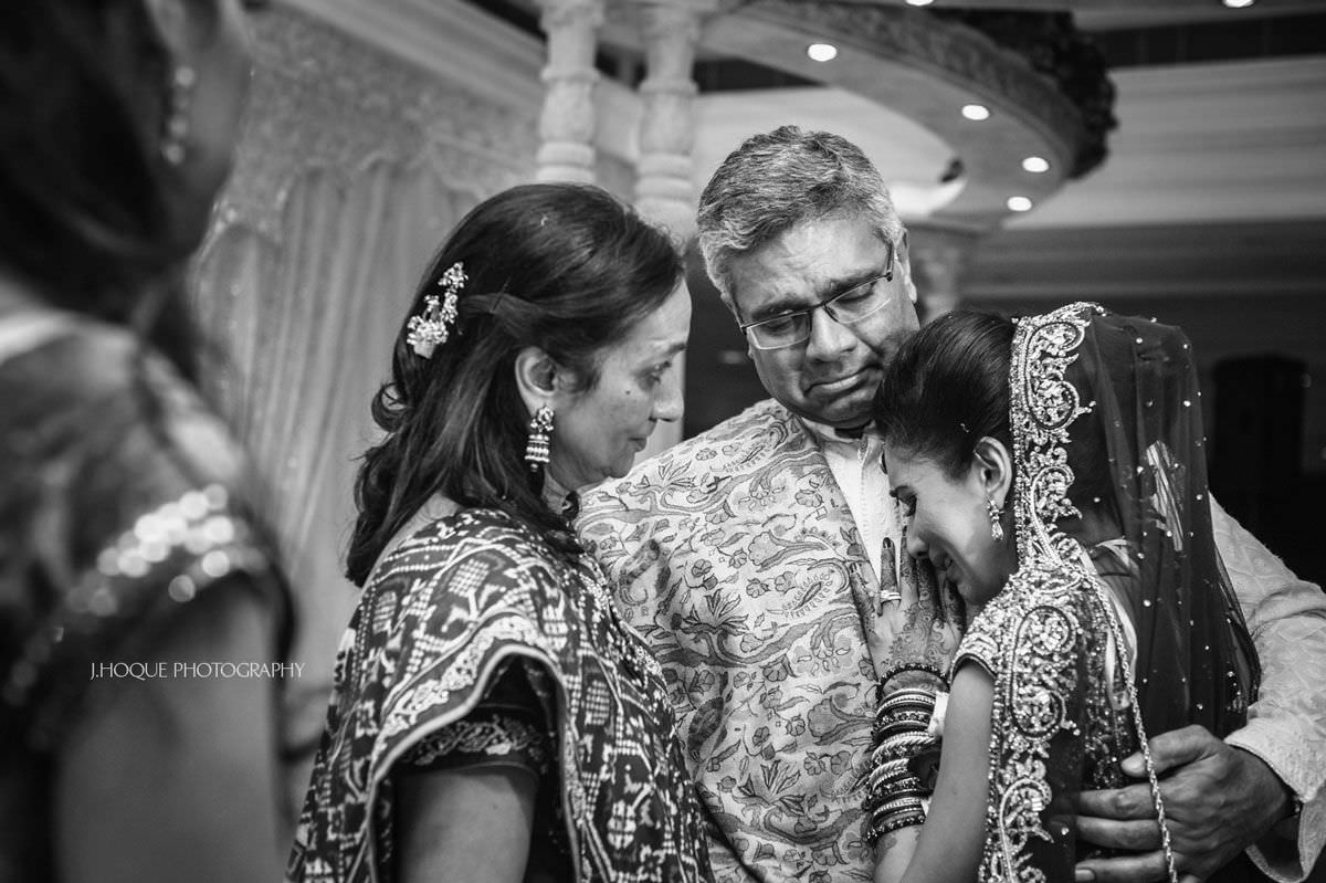 Bride and parents emotional during vidaai ceremony | Luxury Indian Wedding at Intercontinental Park Lane London