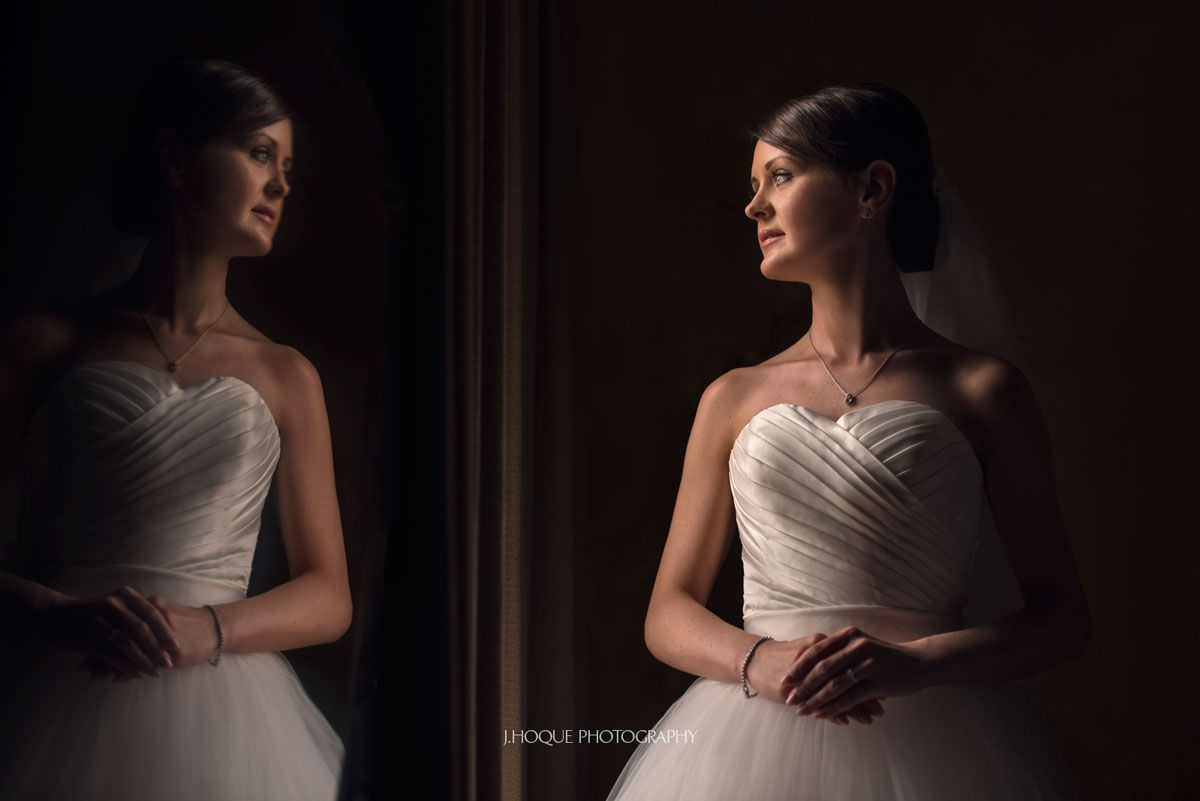 Elegant bride portrait by window | Luxury Wedding Photographer London
