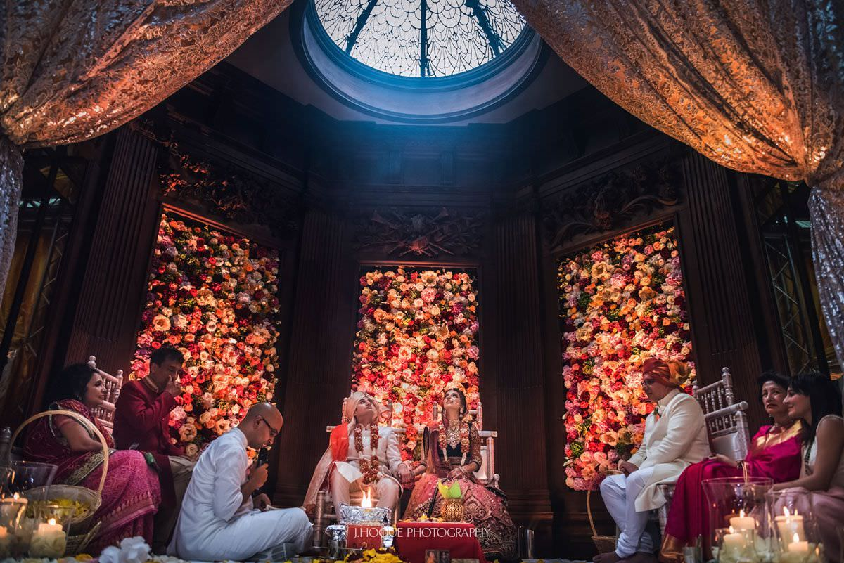Indian bride and groom looking up at light | Luxury Hindu Wedding at Thornton Manor Cheshire