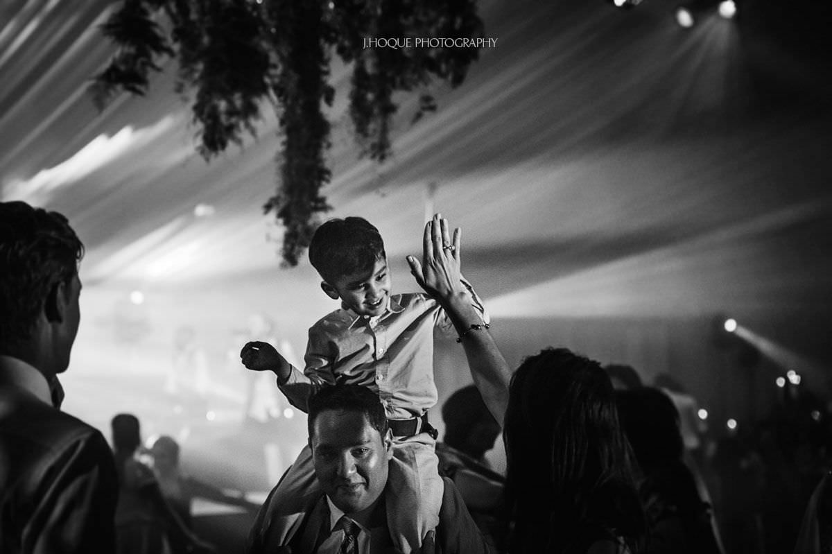 Boy on dads shoulder being hi-fived | Thornton Manor Luxury Indian Wedding Photography