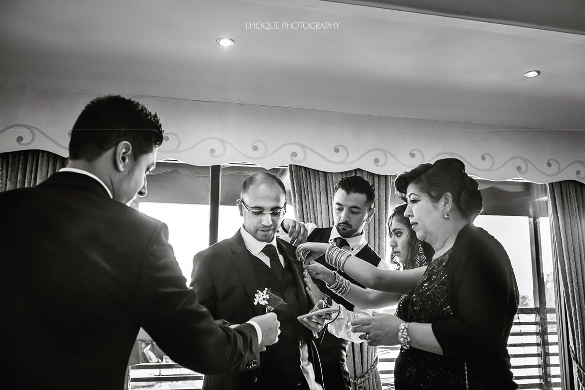 Everyone fussing over the groom | Afghan Pakistani Muslim Fusion Wedding Photography Essex
