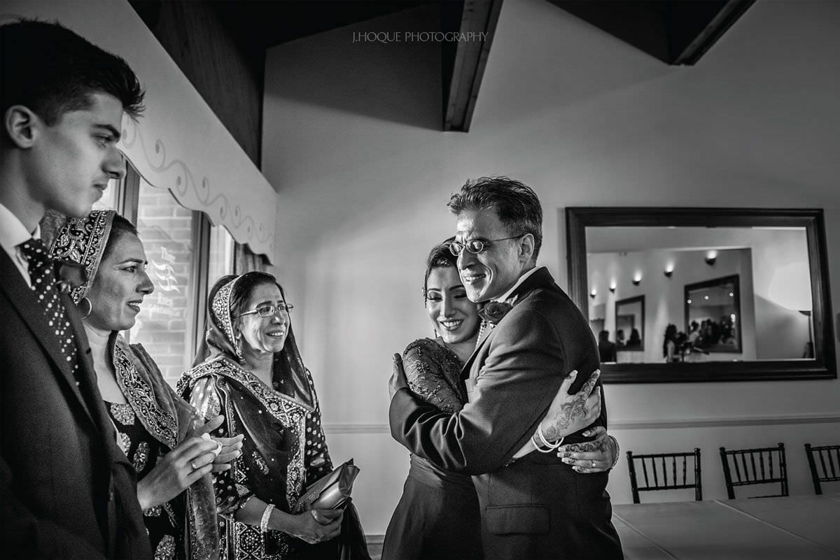 Bride hugging her uncle after Muslim wedding ceremony | Asian wedding at Three Rivers Essex