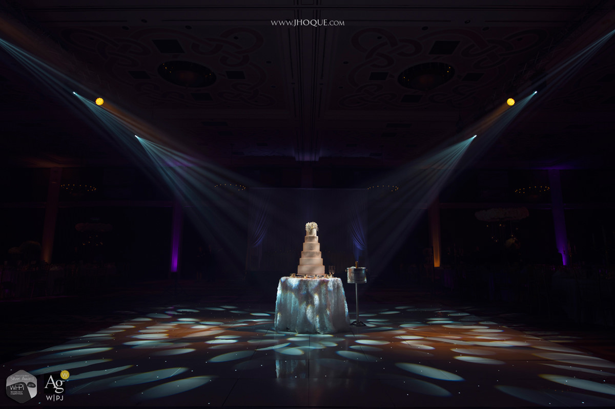 Spotlights pointing at wedding cake | AG|WPJA Award - Q3 2016 | WPPI Silver Award | Luxury Asian Wedding at Celtic Manor Resort Wales | Maya Dahlia Cakes | Pro System Services