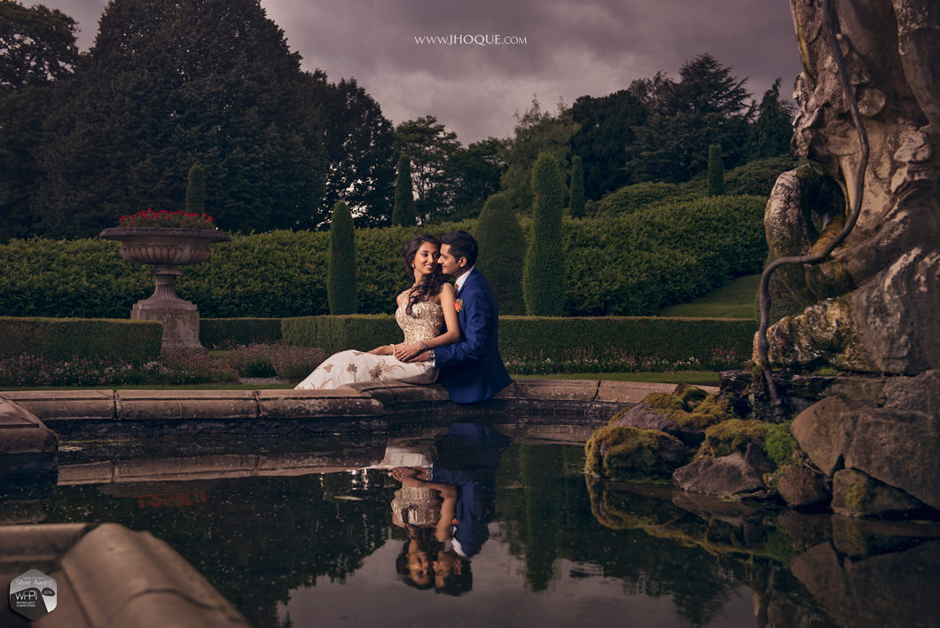 Bride and groom portrait by fountain at Tatton Park | Chashire Indian Wedding Photography