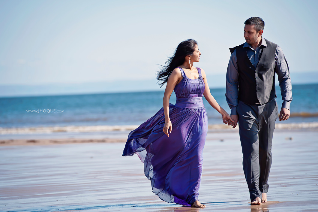 Couple walking on beach | Wales Engagement Shoot | Luxury Indian Wedding Photography
